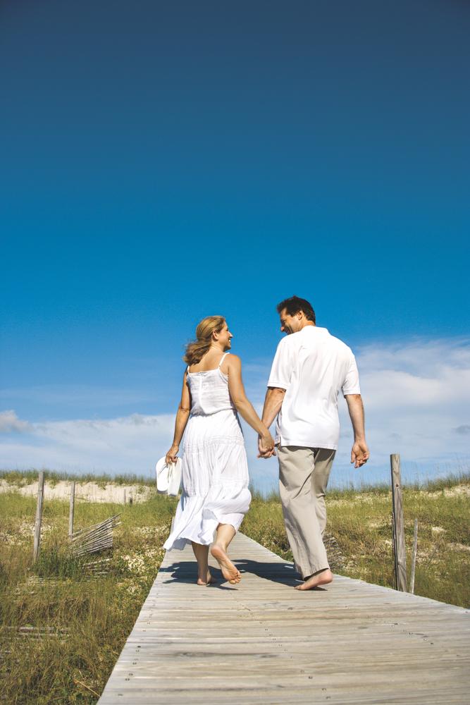 beach; couple; boardwalk