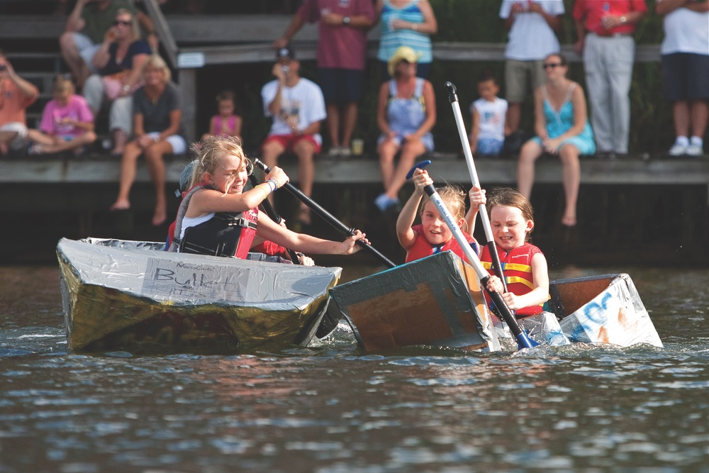 Participants in the annual cardboard boat race give their all—some more successfully than others.