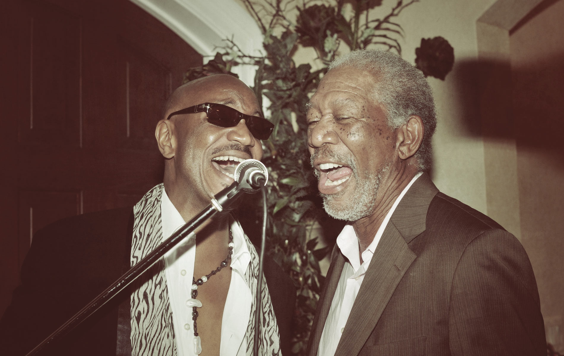 Local celebrity from NBC's The Voice, Geoff McBride, sings with Academy Award– winning Morgan Freeman at the Morgan Freeman dinner, which was auctioned for a significant $80,000 to benefit the Emerald Coast Children's Advocacy Center.