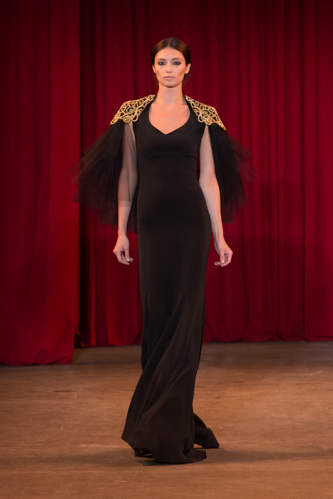 vie magazine fashion week fall 2013 model walks runway black and gold dress