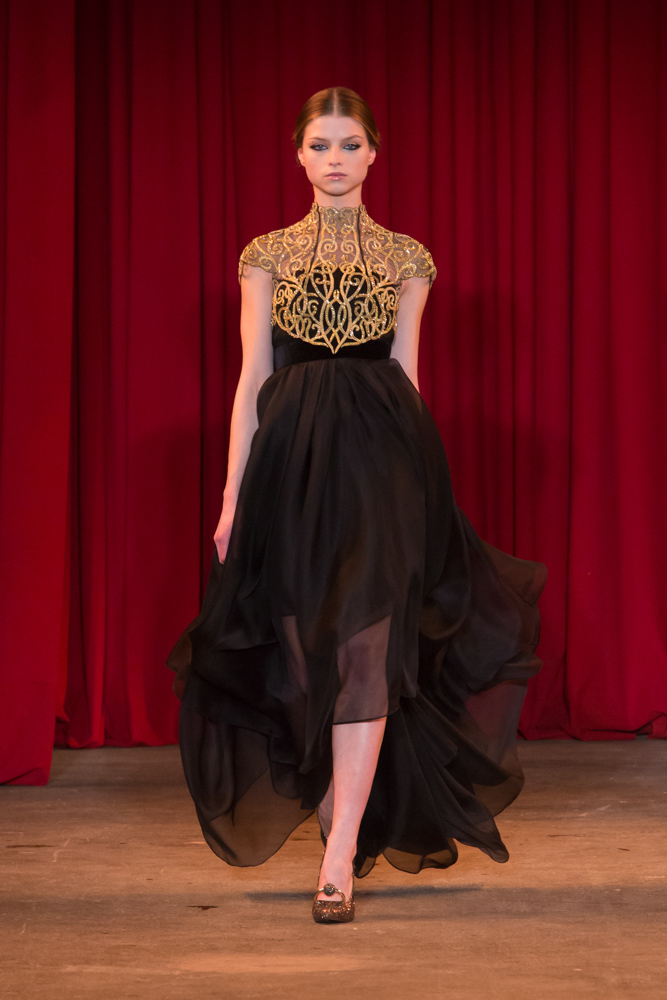 vie magazine fashion week fall 2013 model walks runway black and gold dress
