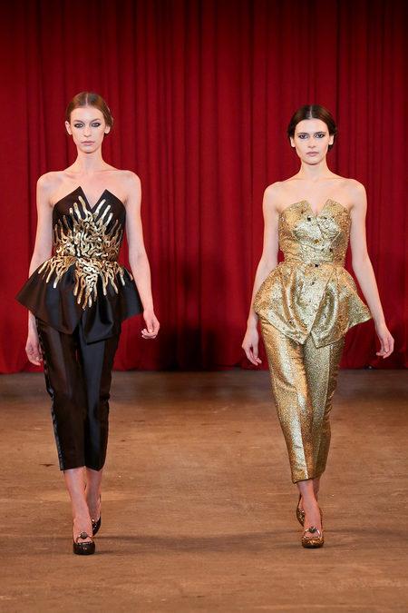 vie magazine fashion week fall 2013 model walks runway black and gold
