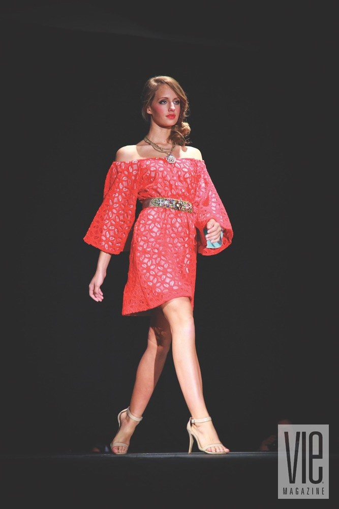 vie magazine south walton fashion week girl on runway red dress