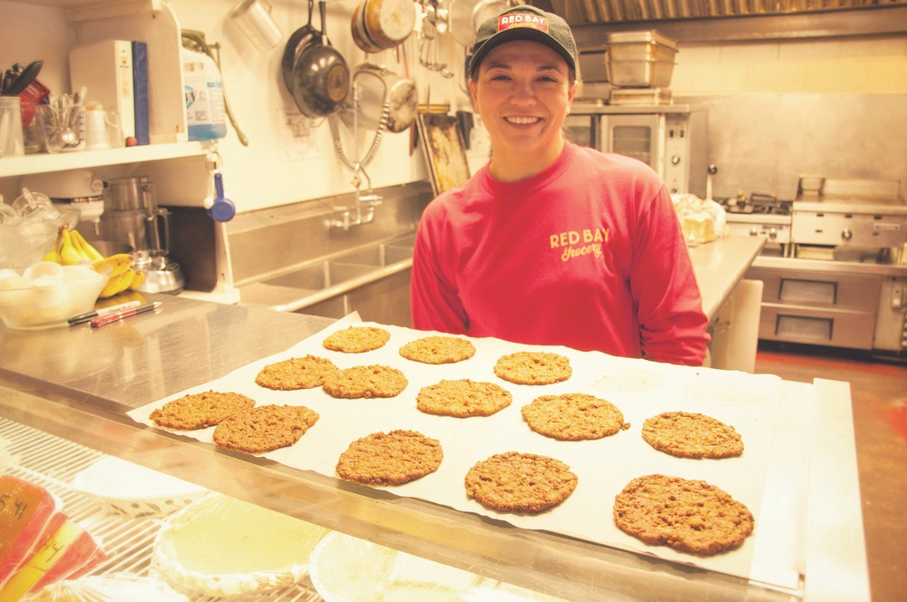 Woman employee baking cookies at Red Bay Grocery