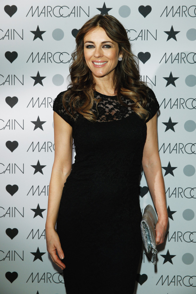 VIE Magazine takes on Berlin Mercedes-Benz Fashion Week Autumn/Winter 2014. Elizabeth Hurley attends the Marc Cain show. Photo by Andreas Rentz
