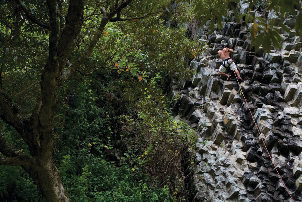 Panama Canal Ecotourism Dreamland Central America. A rock climber in La Amistad International Park in the Boquete region of Panama