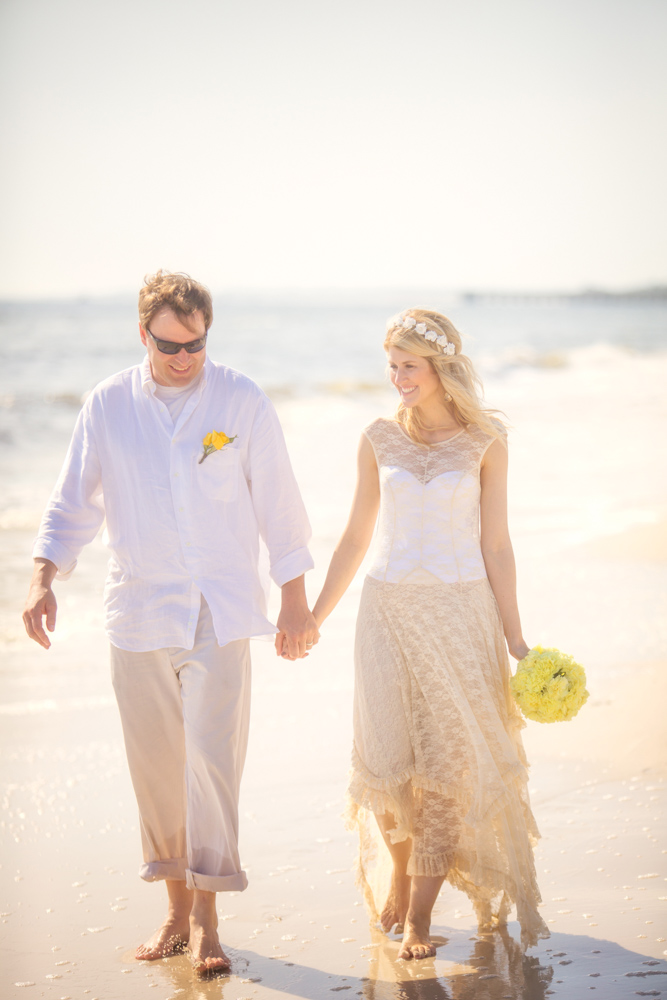 Bride and groom walking along beach at Mexico Beach wedding photo shoot, photos by Romona Robbins