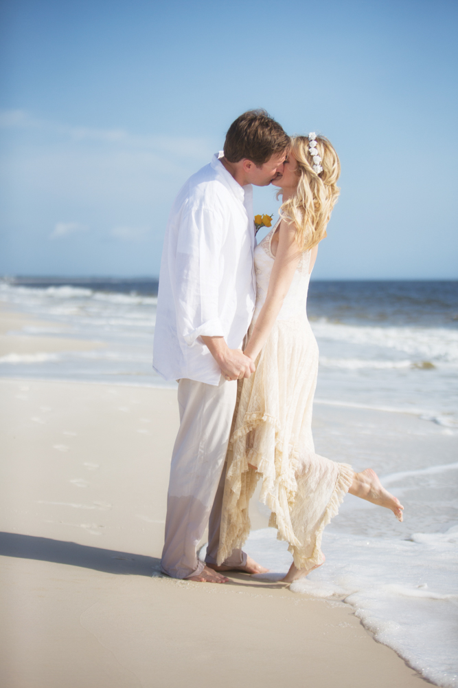 Bride and groom kissing on beach at Mexico Beach wedding photo shoot, photos by Romona Robbins