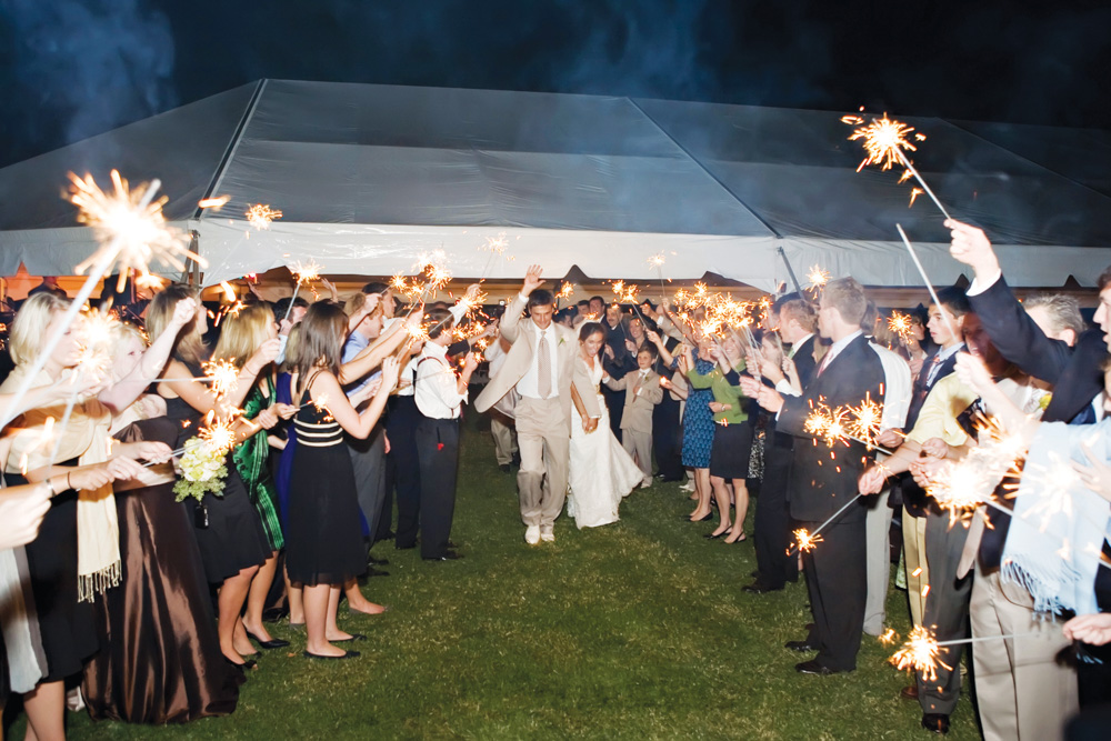 Bride and Groom exiting with sparklers at Vaughn and Tim Spanjer wedding Hamilton Place at Pursell Farms