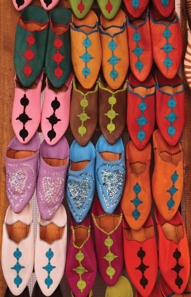 Colorful Moroccan slippers on display in shop