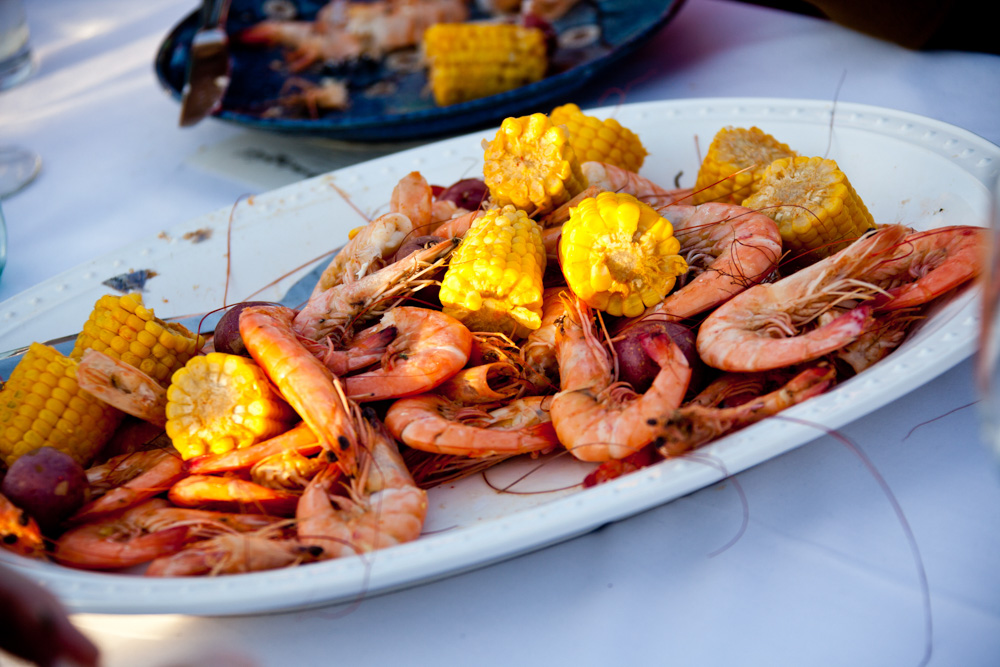 Shrimp and corn on the cob at 13 mile seafood vie magazine