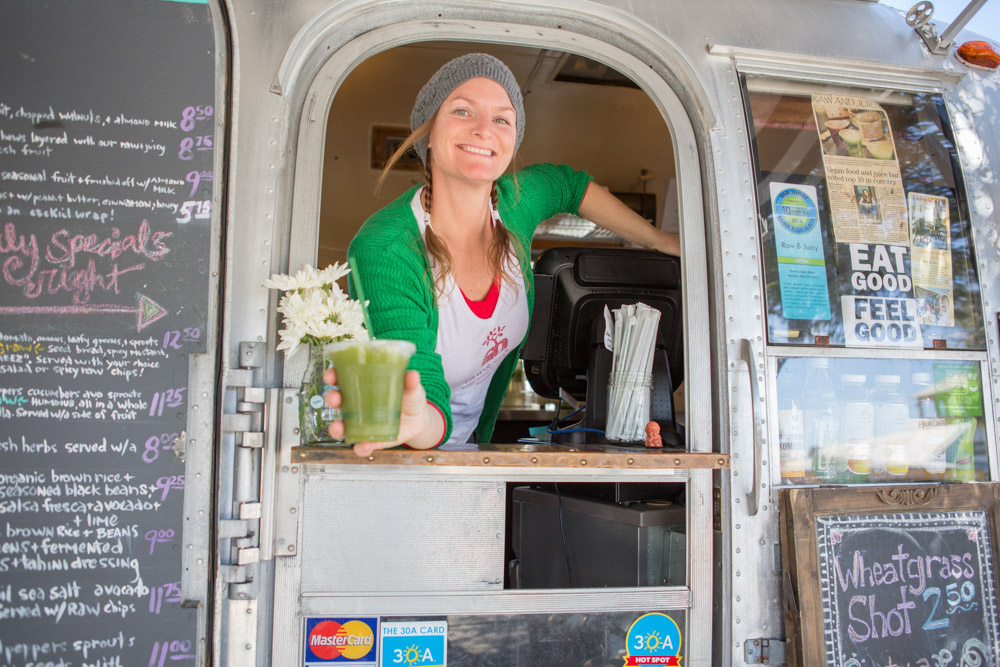 Woman smiling at food truck