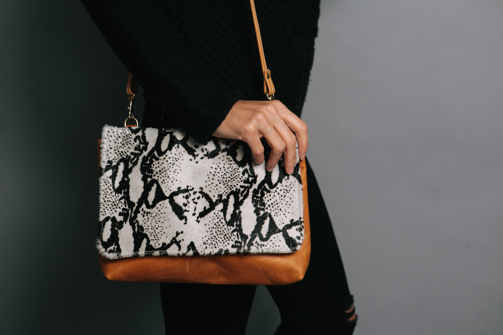 Ceri Hoover's snakeskin print and solid leather over the shoulder handbag