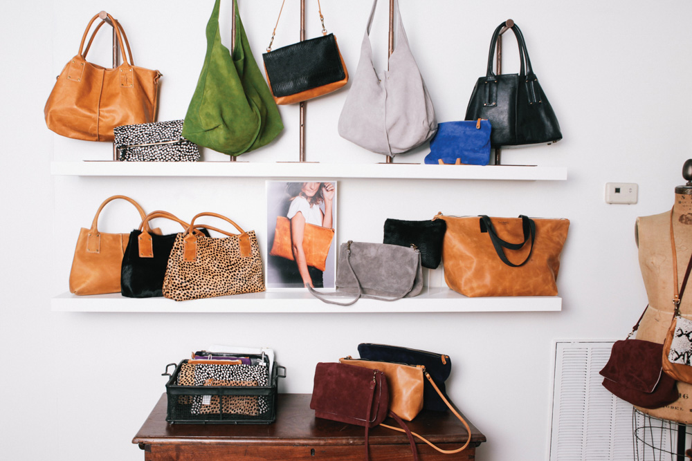 Shelf Display of Ceri Hoover's handbags ranging from color print and styles