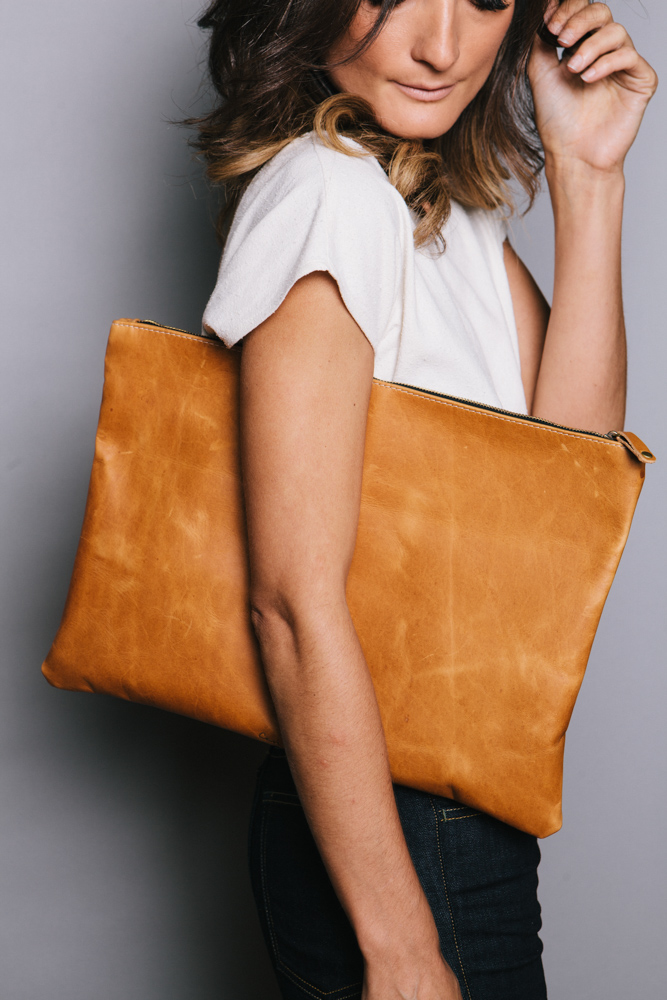 Model Display Of An Oversized Ceri Hoover Cognac Colored Clutch