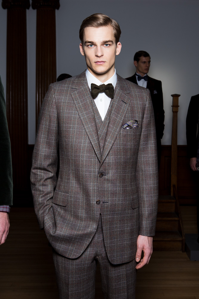 Male Model During London Fashion Week Fall Winter 2015 in cool wool plaid suit