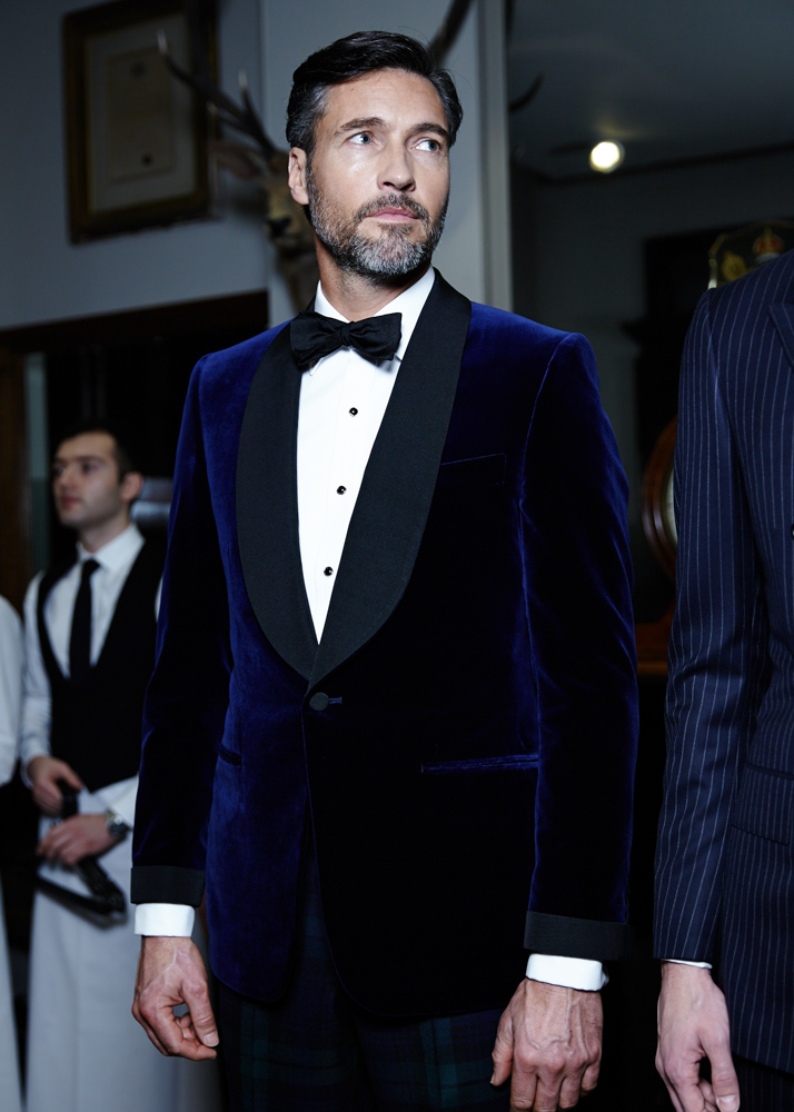 Fashion menswear model donning royal blue velvet suit at London's Fashion Week Fall Winter 2015