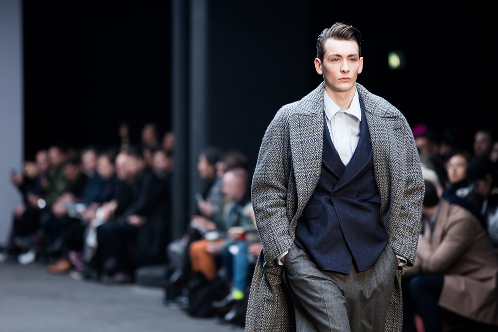 Male model walking down London's Fall Winter 2015 in jacket