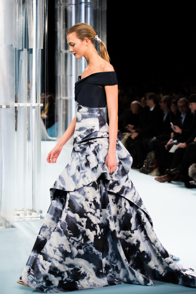 Model in Carolina Herrera evening gown walking down Mercedes Benz Fashion Week