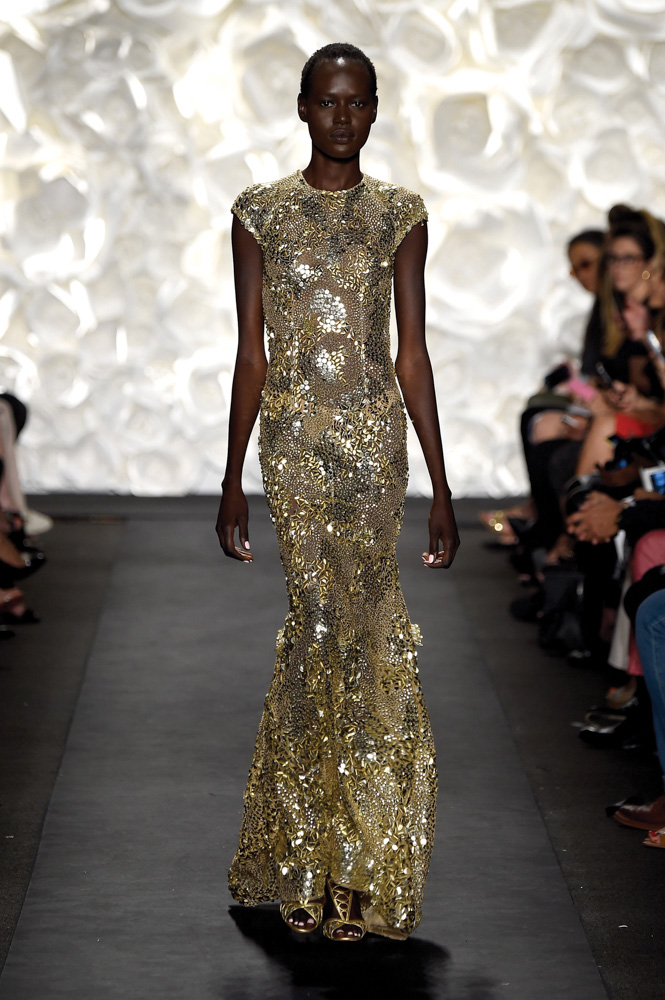 model in gold dress walks runway at Naeem Khan fashion show Mercedes Benz Fashion Week Spring 2015