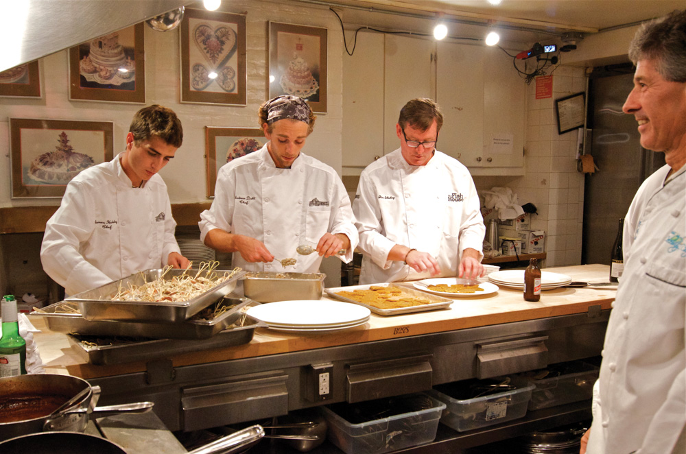 Chef Jim Shirley working with sous chefs at the James Beard House