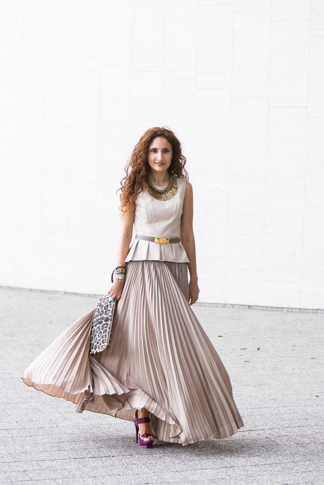 Fashion blogger Sannam Warrender looks romantically chic in knife pleated skirt tank top and waist belt