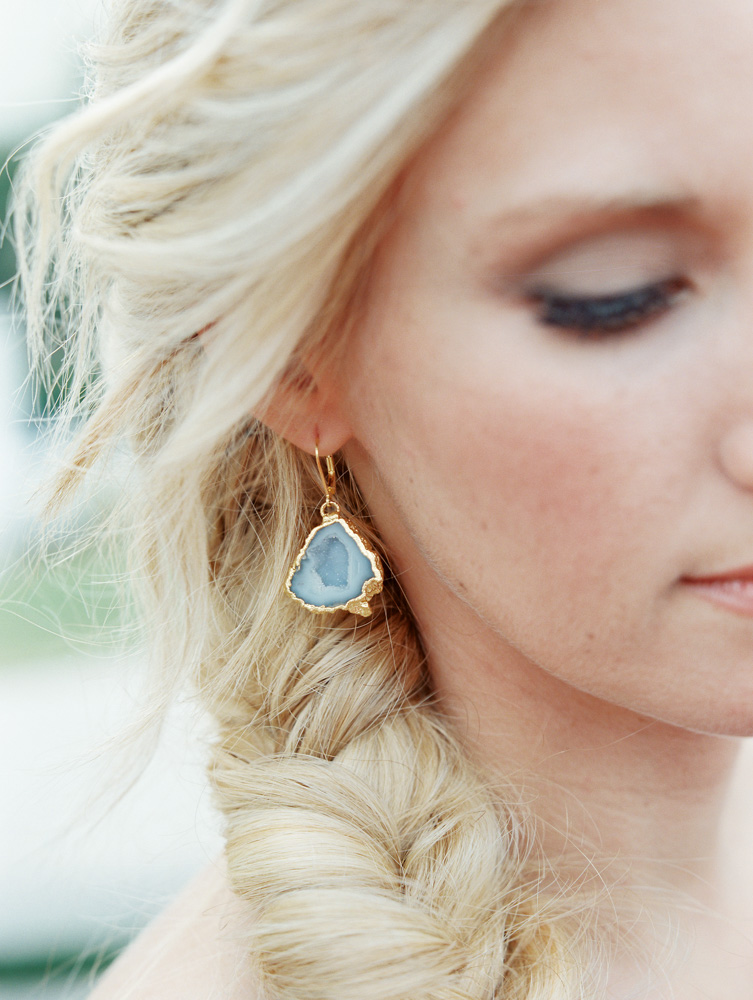 Bride with blue stone earrings
