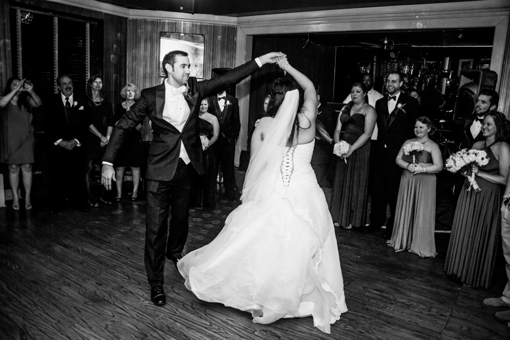 Groom sean twirls bride kristen around