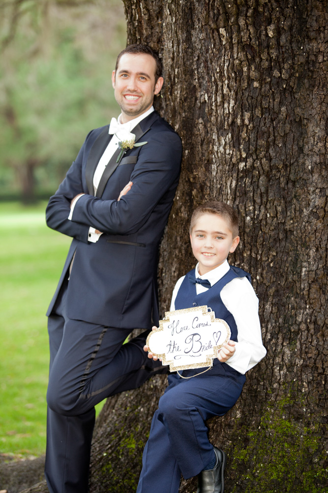 Groom and little boy holding flowers