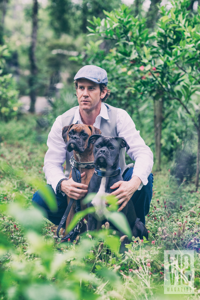 Man with two boxer dogs, styled faux wedding shoot