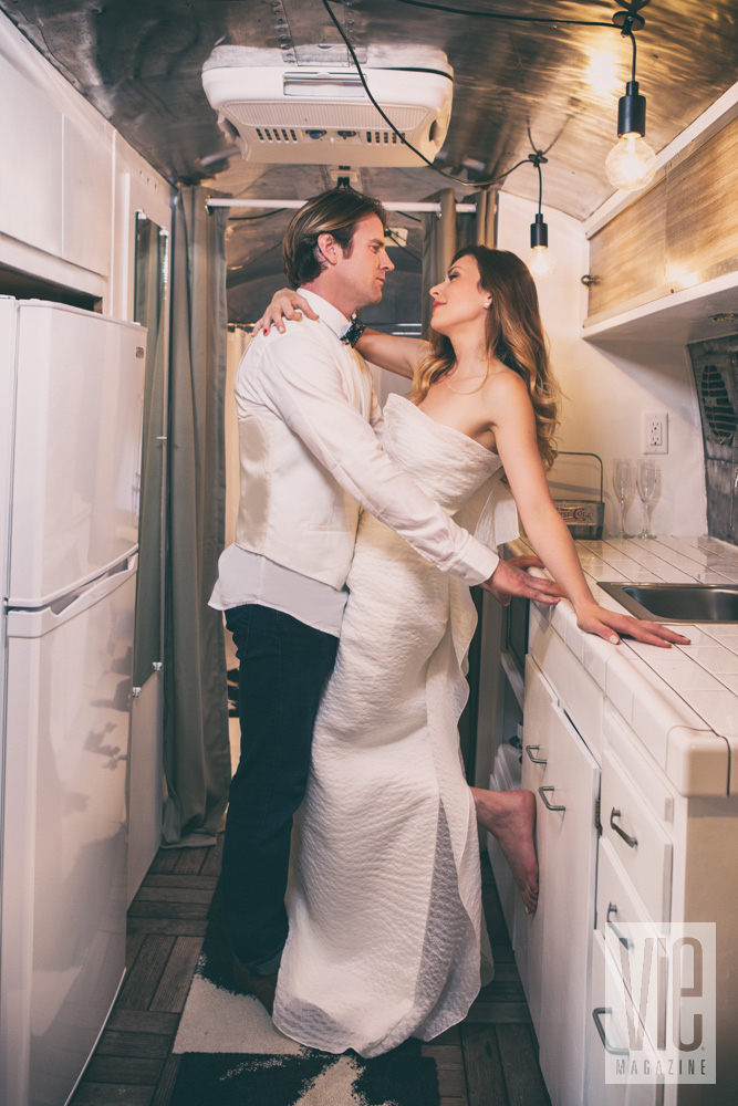 Groom and bride in airstream kitchen