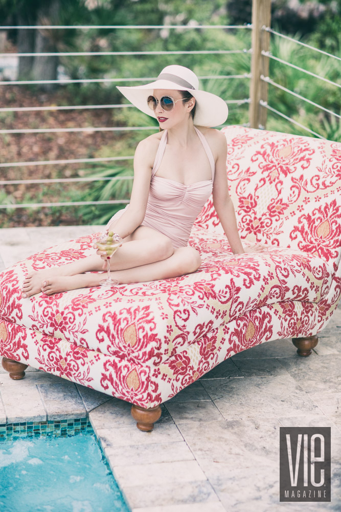 Norma Kamali swimwear; Chloé sunglasses; hat by Gaëlle Le Goff