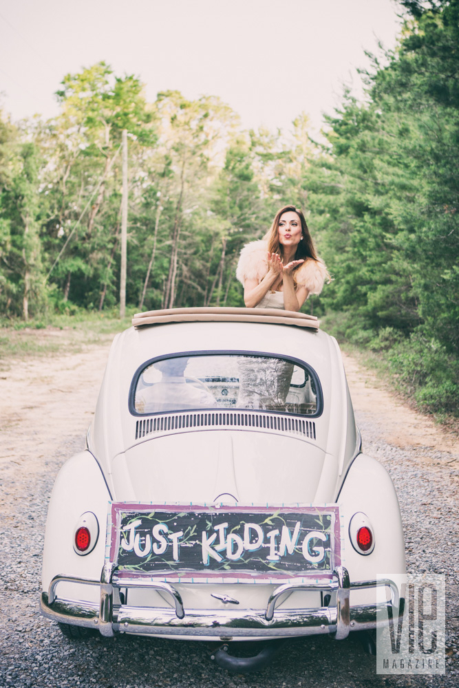 Wedding getaway car with Just Kidding instead of Just Married on rear