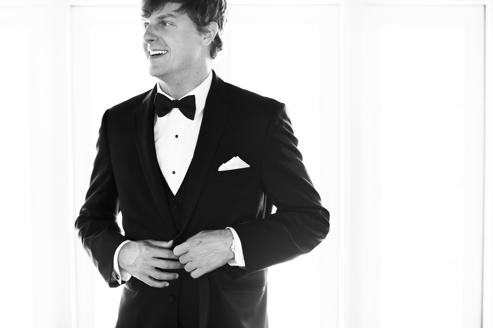 Josh wearing a suit for the wedding