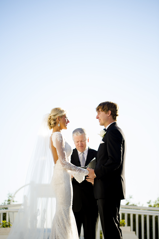 lauren and josh saying their vows at the alys beach wedding