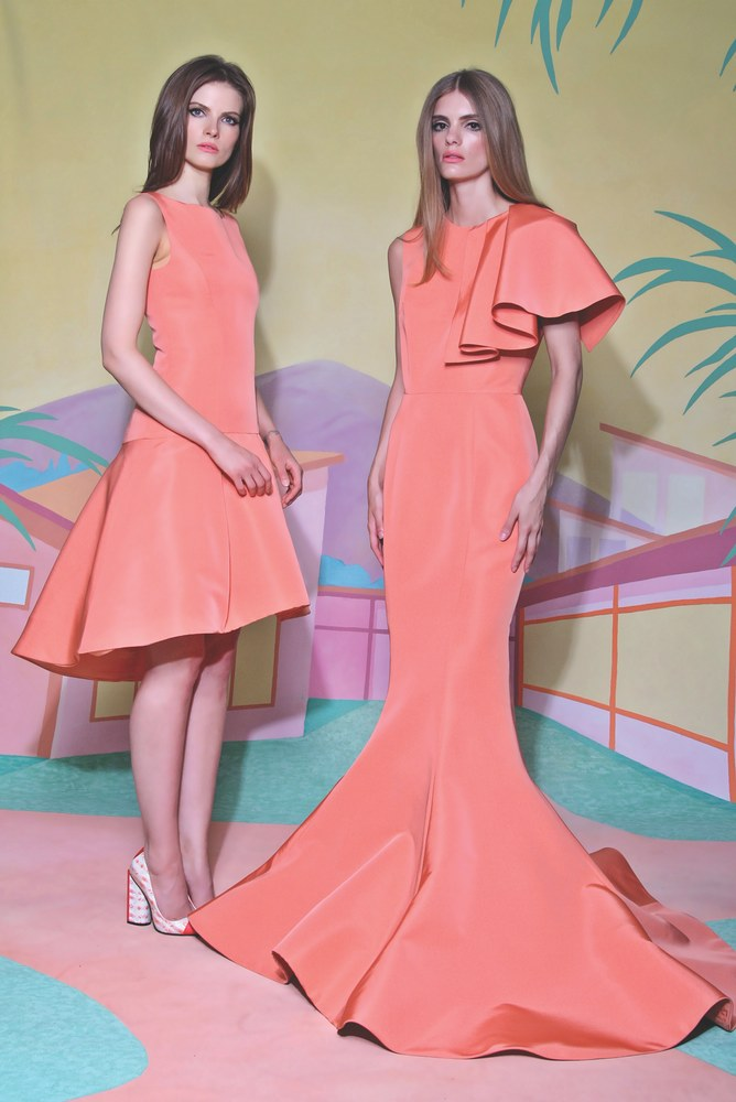 fashion models wearing orange dresses by christian siriano