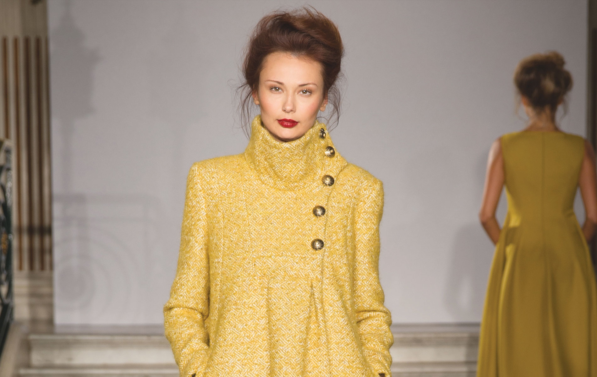 model on runway in a yellow dress designed by paul costelloe
