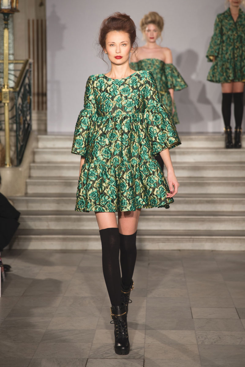 model wearing green paul costelloe dress