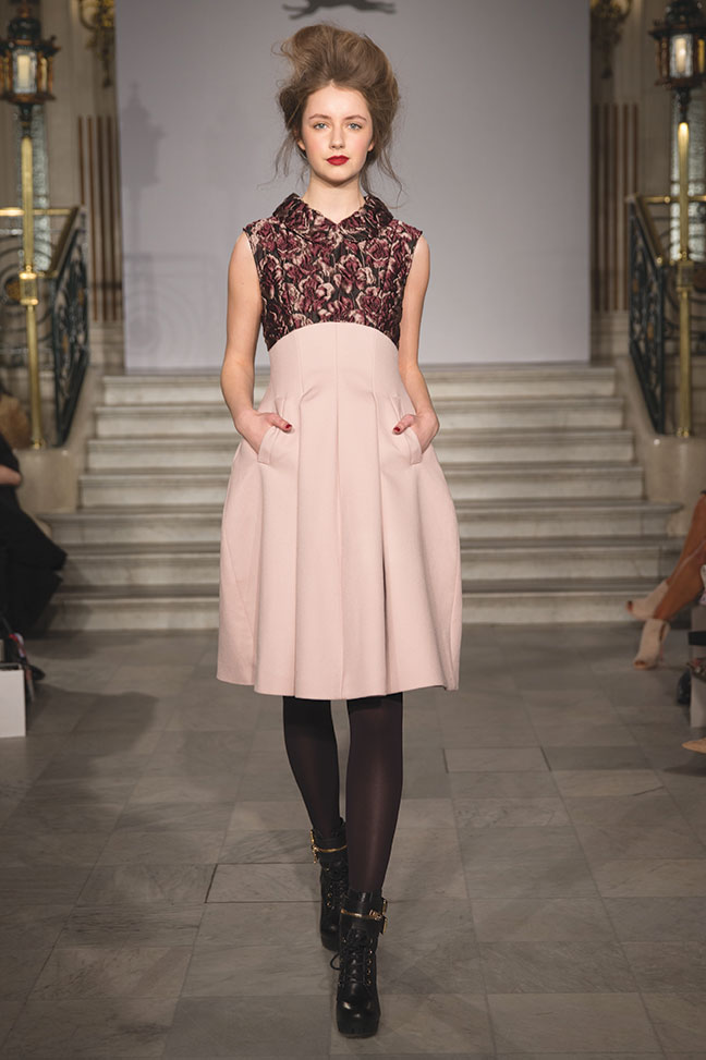 model wearing pink paul costelloe dress