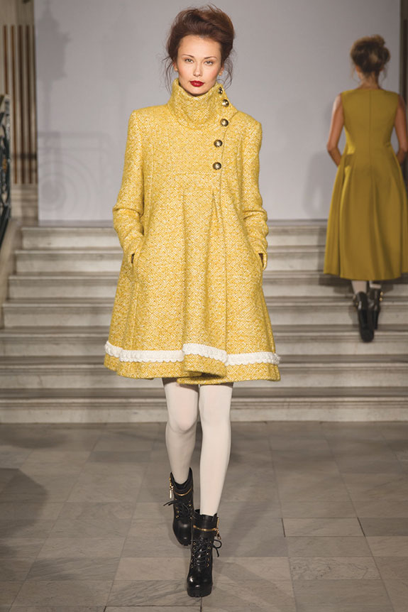 woman wearing yellow paul costelloe dress