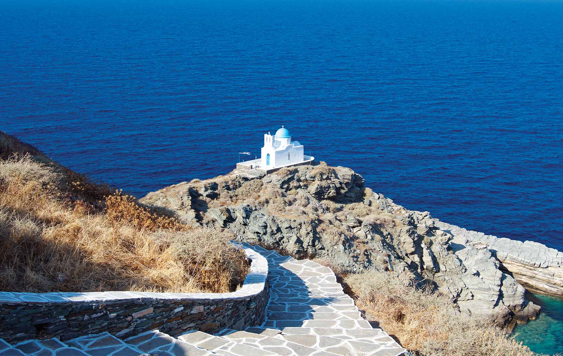 House on a cliff in Greece near the ocean