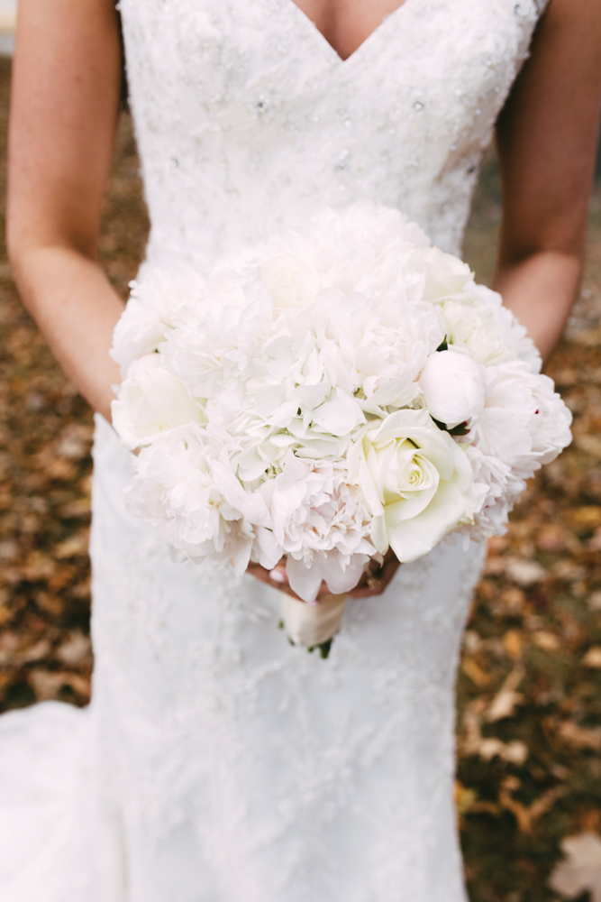 Ainsley holds her wedding bouquet