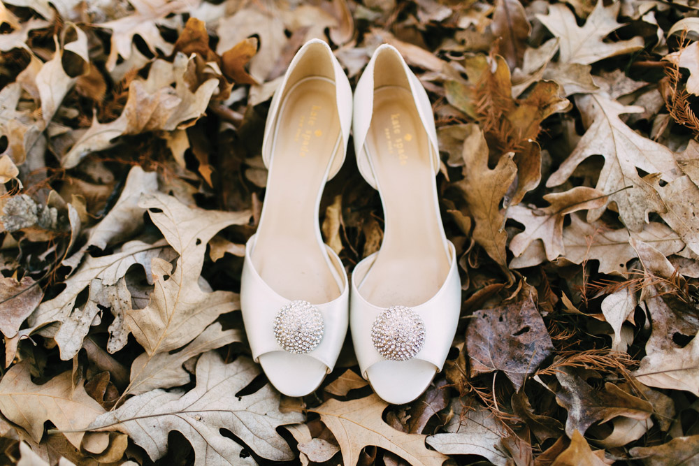 Wedding shoes in leaves