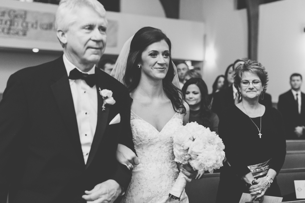 Ainsley and her father walk down the aisle