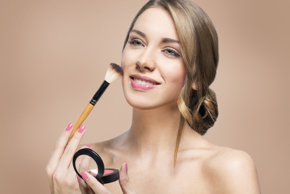 Woman putting makeup on