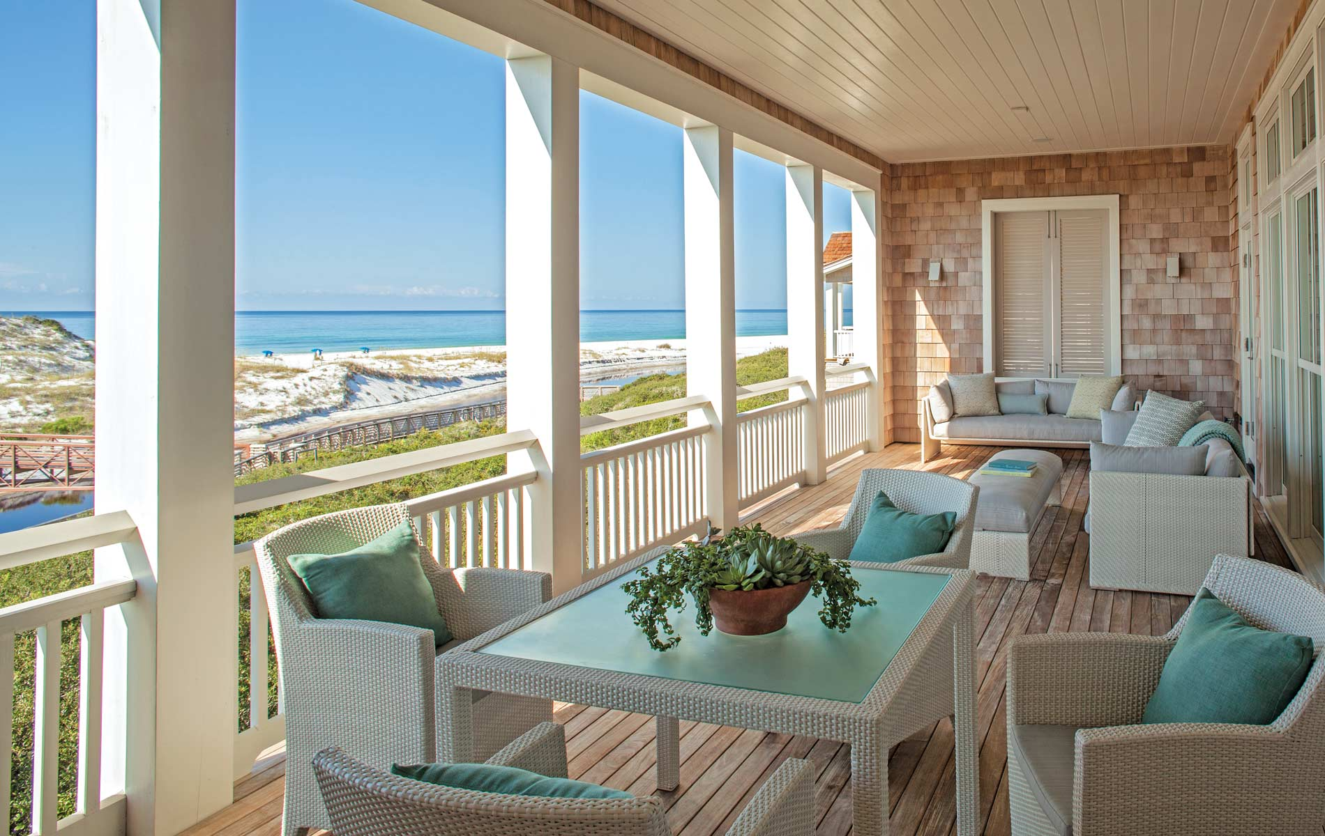 Deck with beach view and chairs