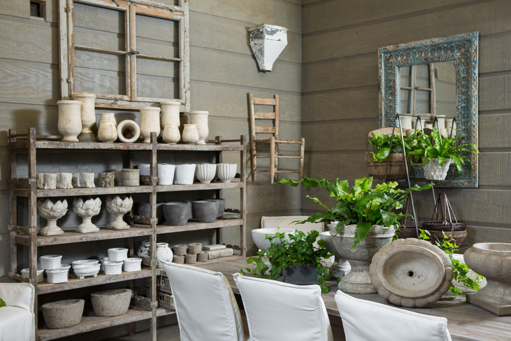Simple wood shelving and white pottery