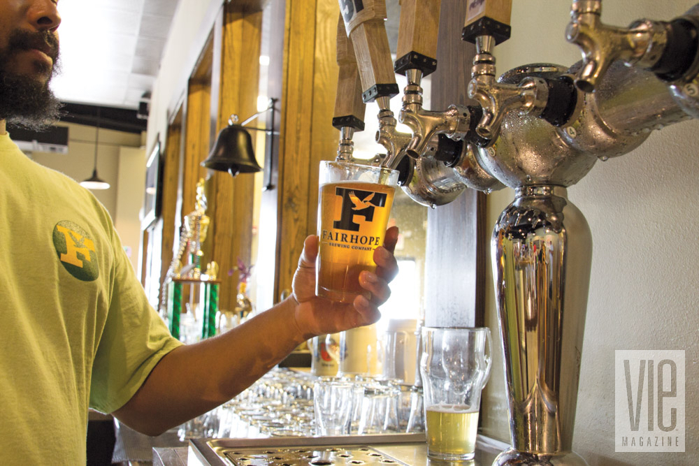 Pouring beer from a tap at Fairhope Brewing Company in Alabama