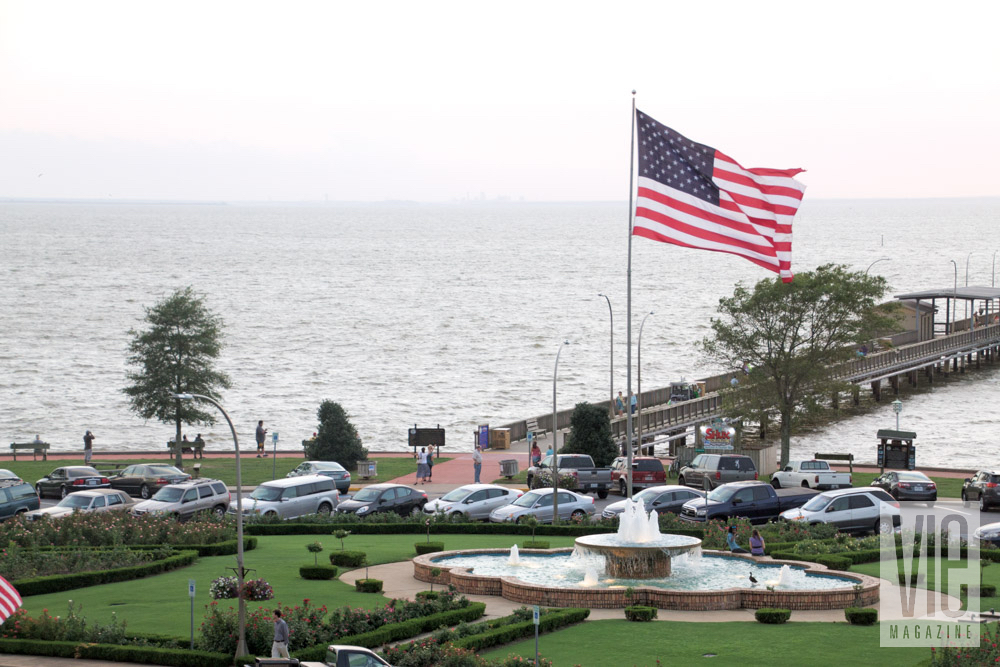 American flag waving in the wind at dock in Fairhope, Alabama