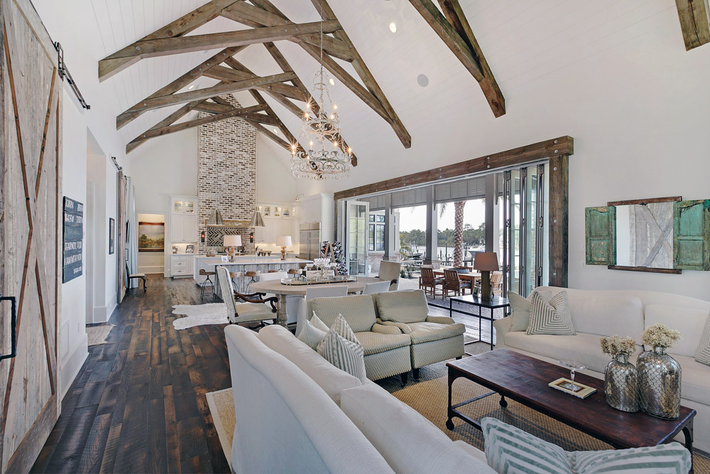 Open beams in Gulf Coast home Living room Geoff Chick